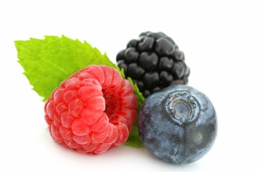 Summer berries on white