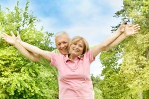 happy elderly couple outdoors