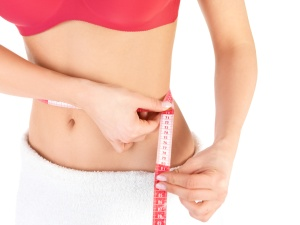 Healthcare and fitness - young fitness female keeping her diet.