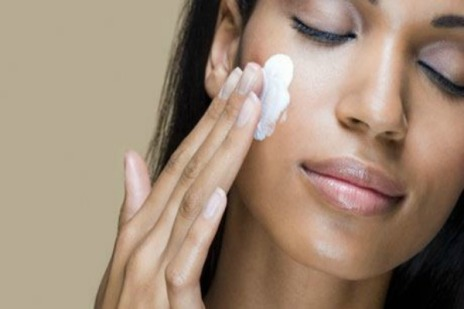 A-woman-rubbing-moisturiz-009